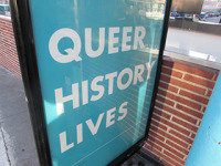 A sign in from the GLBT museum.